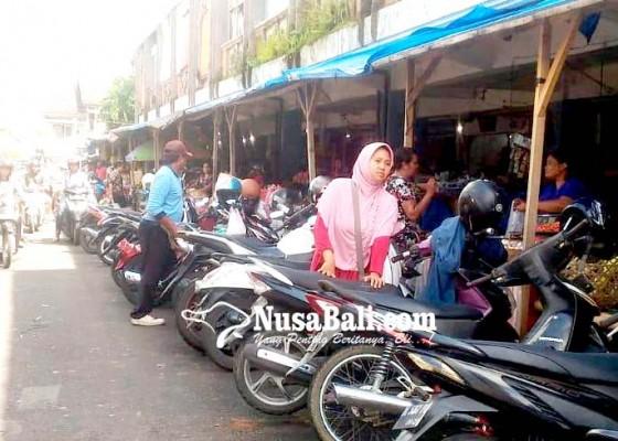 Nusabali.com - pencuri-helm-beraksi-di-pasar-kidul