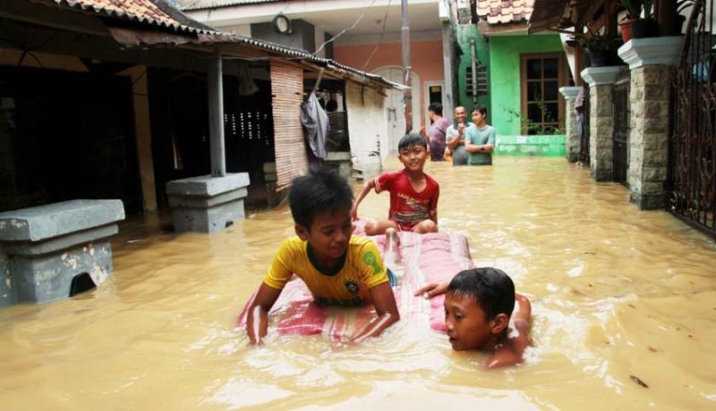www.nusabali.com-banjir-luapan-sungai-ciliwung