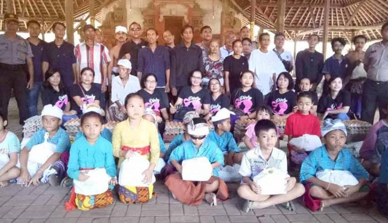 www.nusabali.com-alumni-sman-2-amlapura-sumbang-kursi-roda-dan-sembako