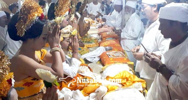 www.nusabali.com-pertamakali-digelar-di-desa-pecatu-metatah-massal-diikuti-104-krama