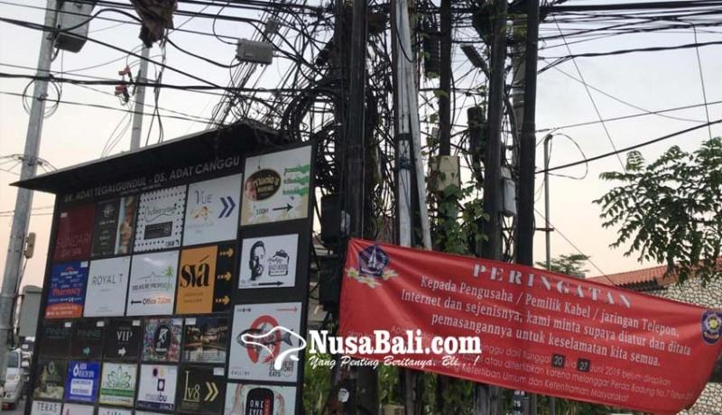 www.nusabali.com-satpol-pp-siap-babat-kabel-semrawut-di-kuta