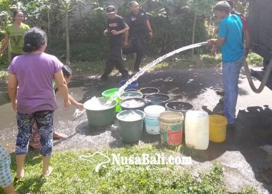 Nusabali.com - krama-banjar-belatung-dapat-bantuan-air-bersih