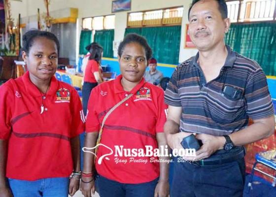 Nusabali.com - smkn-1-amlapura-kebagian-2-siswa-papua