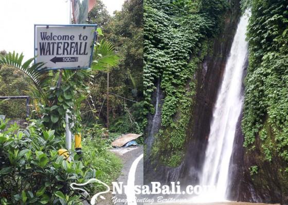Nusabali.com - air-terjun-munduk-secercah-keindahan-tersembunyi-sebuah-perjalanan-histori