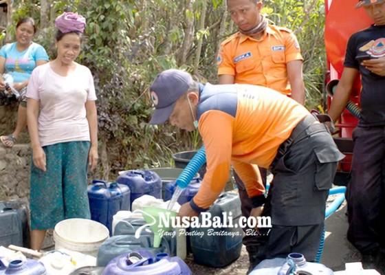 Nusabali.com - act-distribusikan-air-bersih-untuk-enam-banjar