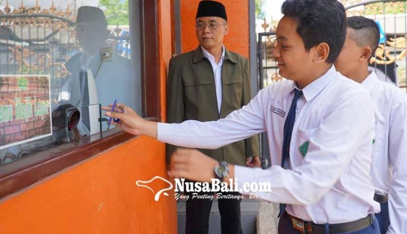 www.nusabali.com-kasek-smp-mengajar-nol-jam