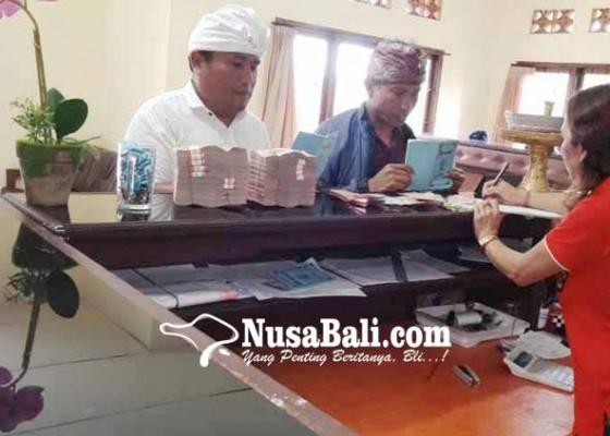 Nusabali.com - lpd-besakih-layani-samsat-online