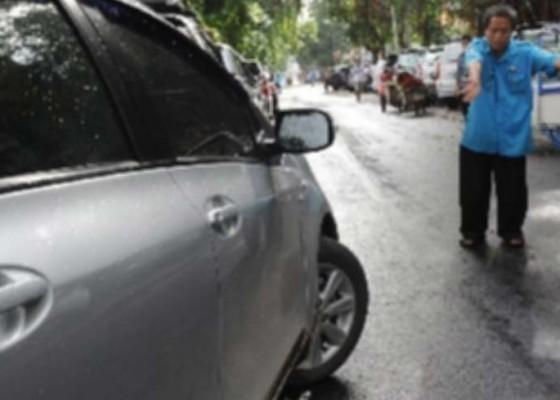 Nusabali.com - tarif-pakir-mobil-rp-5-ribu-dipertanyakan