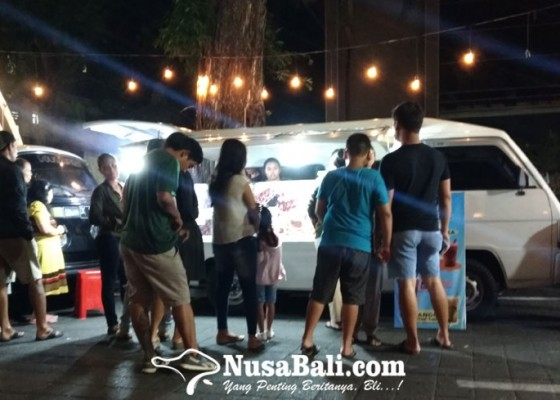 Nusabali.com - ada-sate-biawak-di-lapangan-puputan-badung-yuk-coba