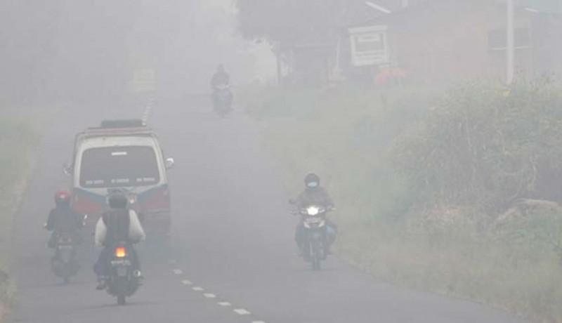 www.nusabali.com-pekanbaru-berkabut-asap-4-pesawat-gagal-mendarat