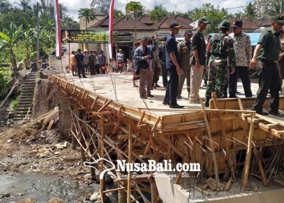 Nusabali.com - jembatan-tmmd-permudah-krama-lakukan-upacara-nganyut