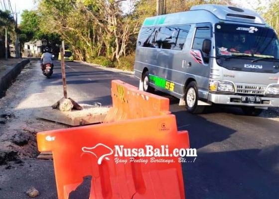 Nusabali.com - pembangunan-usai-beberapa-titik-jalan-dharmawangsa-masih-berlubang