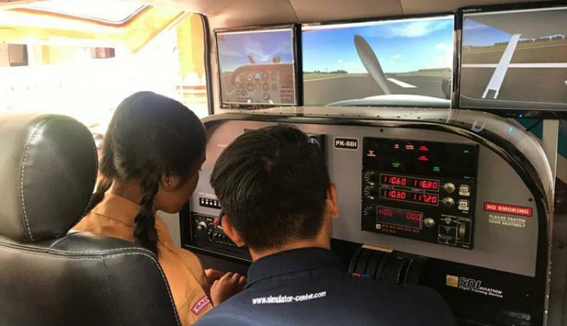 www.nusabali.com-mobil-simulator-pesawat-smk-penerbangan-cakra-nusantara-pertama-dan-satu-satunya-di-indonesia