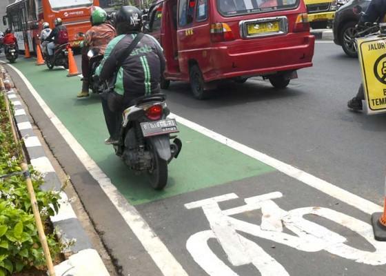 Nusabali.com - perluasan-jalur-sepeda-di-ibu-kota-ditunda