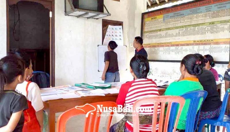 www.nusabali.com-ujian-keaksaraan-diikuti-1409-warga-belajar