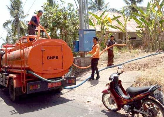 Nusabali.com - bpbd-distribusikan-air-bersih-di-dua-desa