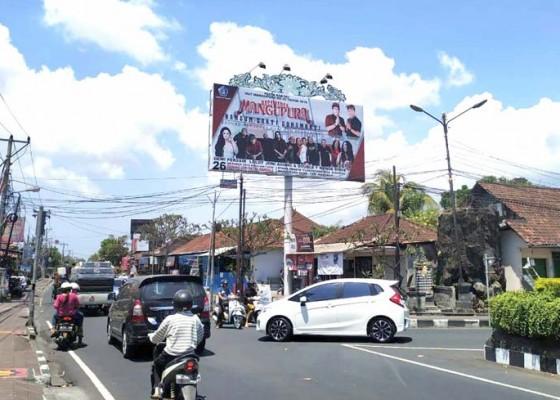 Nusabali.com - hut-mangupura-ke-10-sudah-selesai-billboard-masih-terpampang