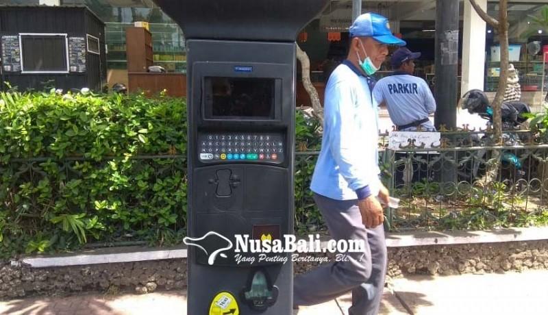 www.nusabali.com-mesin-e-parkir-mangkrak
