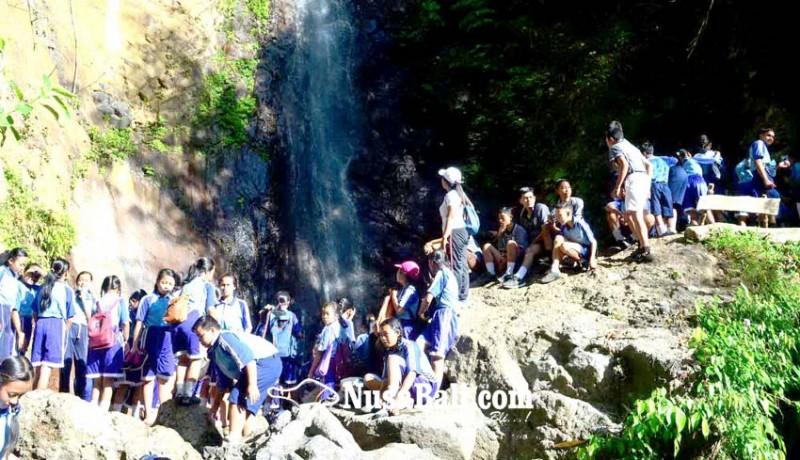 www.nusabali.com-jelang-terima-rapor-smpn-3-selat-jalan-santai