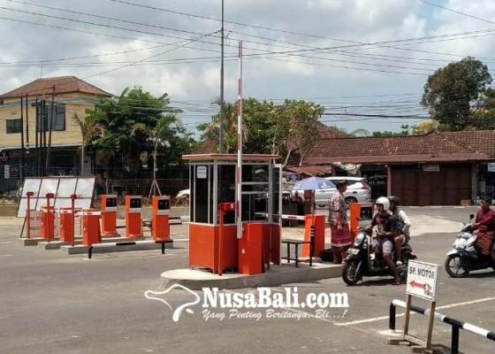 Nusabali.com - sistem-e-parkir-pasar-umum-beringkit-diresmikan-hari-ini