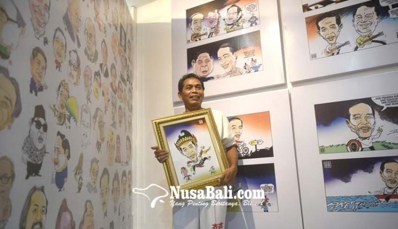 www.nusabali.com-gun-gun-pamerkan-200-kartun-tentang-jokowi