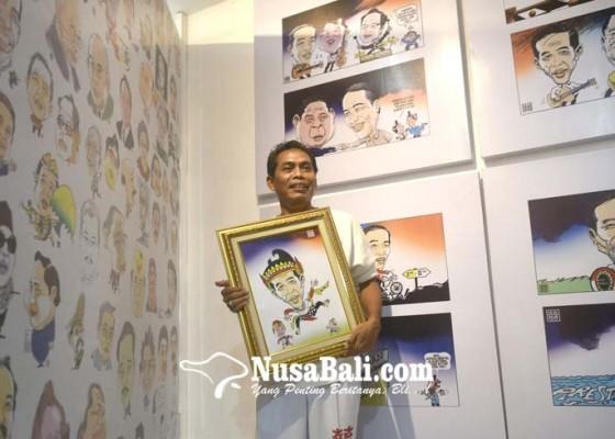 Nusabali.com - gun-gun-pamerkan-200-kartun-tentang-jokowi