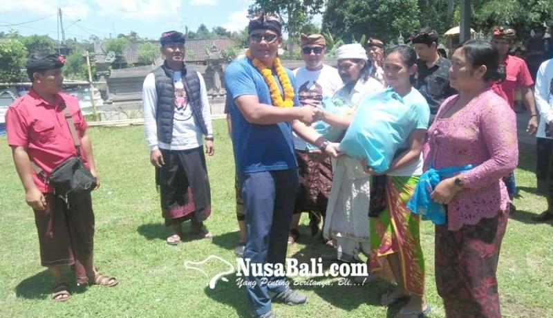 www.nusabali.com-polres-gianyar-bantu-kk-miskin-di-payangan