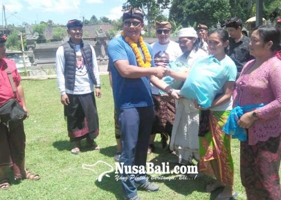 Nusabali.com - polres-gianyar-bantu-kk-miskin-di-payangan