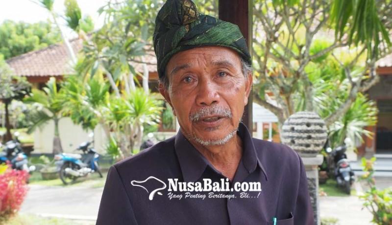 www.nusabali.com-pemundut-sesuhunan-sang-hyang-jaran-seberangi-jurang-naik-titian-batang-kayu