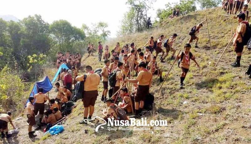 www.nusabali.com-kamabigus-lantik-246-pramuka-smpn-1-manggis