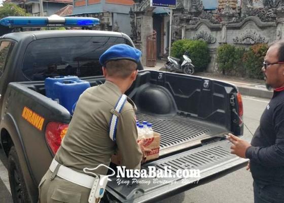 Nusabali.com - polres-jembrana-sita-121-liter-arak