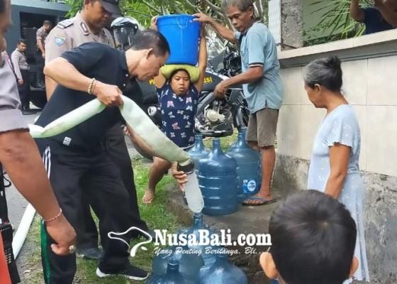 Nusabali.com - warga-desa-besan-terima-bantuan-air-bersih