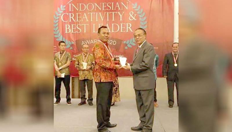 www.nusabali.com-tirta-tohlangkir-raih-best-leader-award