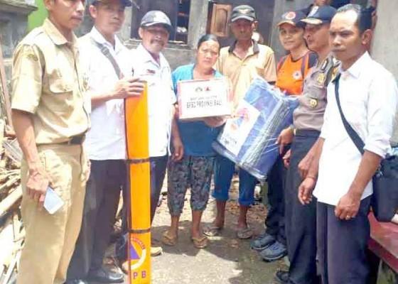 Nusabali.com - bpbd-bersihkan-tumpukan-material-banjir