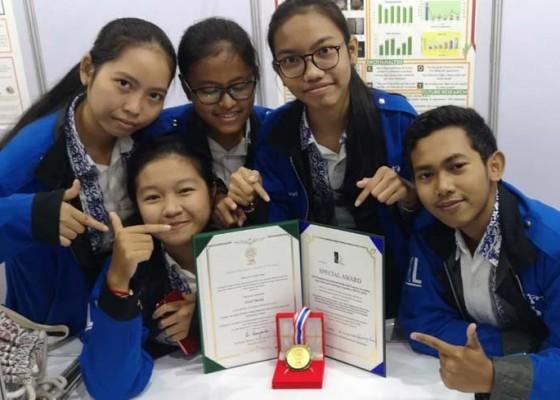 Nusabali.com - sman-3-denpasar-raih-1-emas-1-perak-4-perunggu-kompetisi-ilmiah-di-thailand