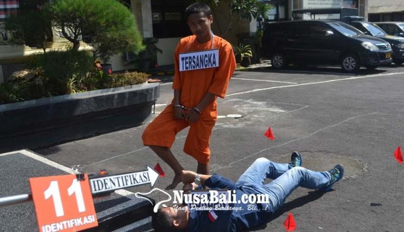 www.nusabali.com-dua-tersangka-peragakan-13-adegan-saat-habisi-korban