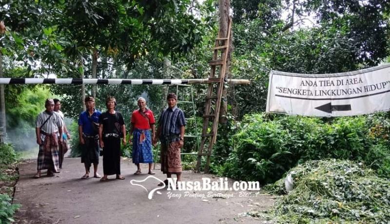 www.nusabali.com-tuntut-rekomendasi-adat-dicabut-warga-bila-blokade-akses-usaha-peternakan-babi