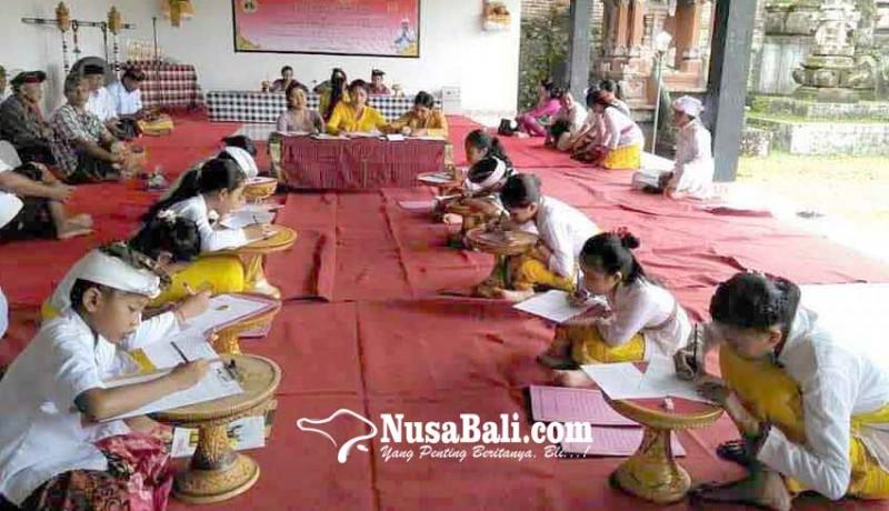 www.nusabali.com-desa-tamanbali-gelar-lomba-ngelawar-dan-banten-caru