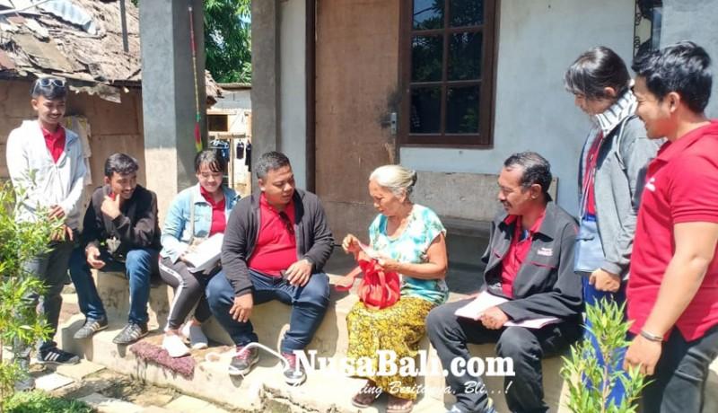 www.nusabali.com-puluhan-kk-miskin-di-ubud-terima-bantuan-daging-babi