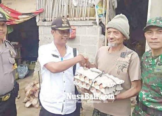 Nusabali.com - perbekel-tegallinggah-bantu-7-lansia
