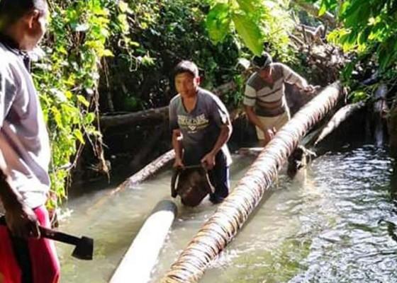 Nusabali.com - pelanggan-pdam-di-desa-abuan-dapat-air-keruh