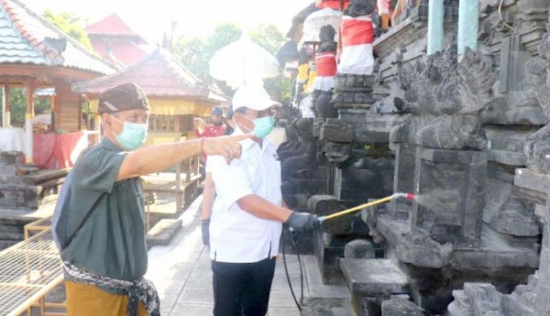 www.nusabali.com-pura-dan-masjid-di-buleleng-disemprot-disinfektan