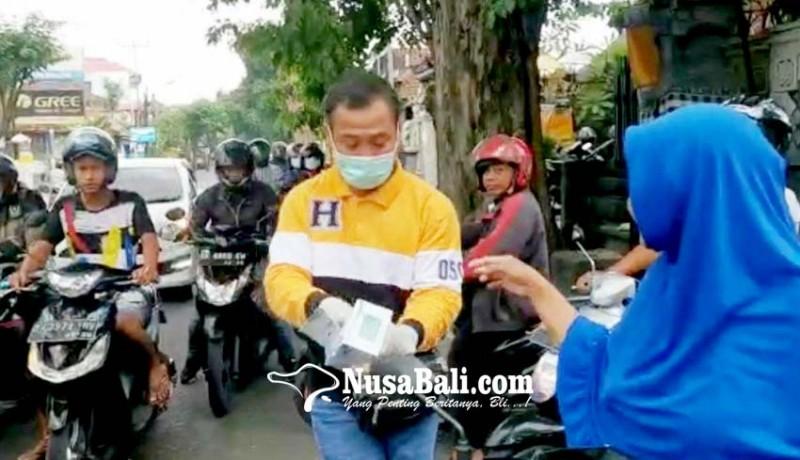www.nusabali.com-ludes-hanura-bagikan-20000-masker-gratis