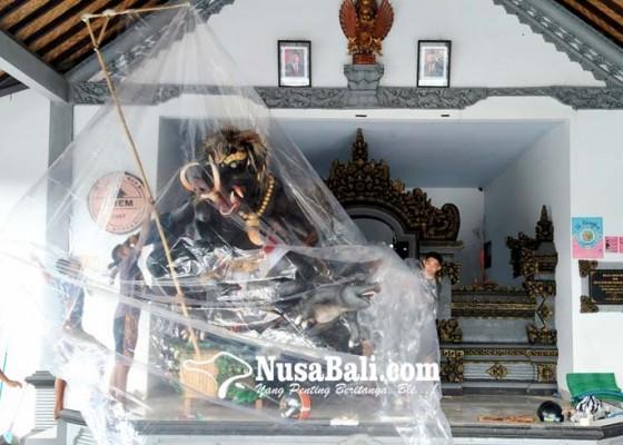 Nusabali.com - batal-diarak-ogoh-ogoh-dibungkus-plastik