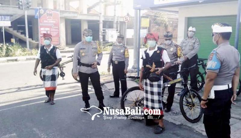 www.nusabali.com-polisi-jaga-pintu-masuk-gianyar-saat-ngembak-geni