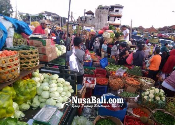 Nusabali.com - mulai-hari-ini-jam-operasional-pasar-dan-toko-dibatasi