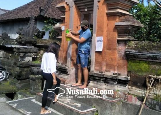 Nusabali.com - warga-banjar-patas-taro-sediakan-disinfektan-di-setiap-angkul-angkul