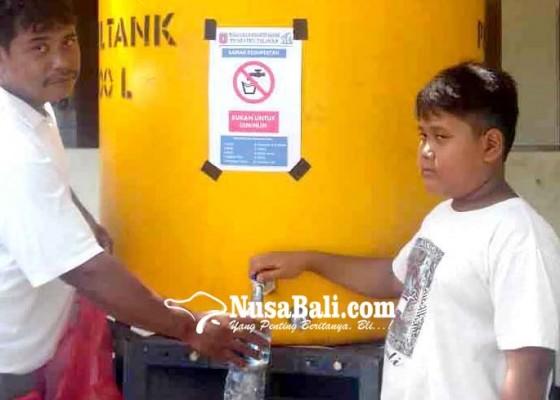 Nusabali.com - perumda-tirta-tohlangkir-siapkan-disinfektan-gratis