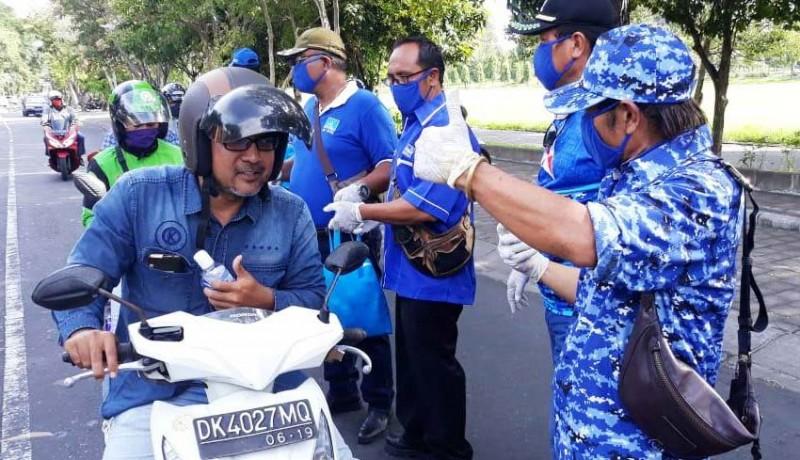 www.nusabali.com-fraksi-demokrat-denpasar-gelontor-masker-dan-disinfektan