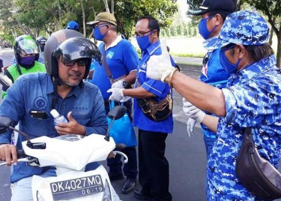 Nusabali.com - fraksi-demokrat-denpasar-gelontor-masker-dan-disinfektan